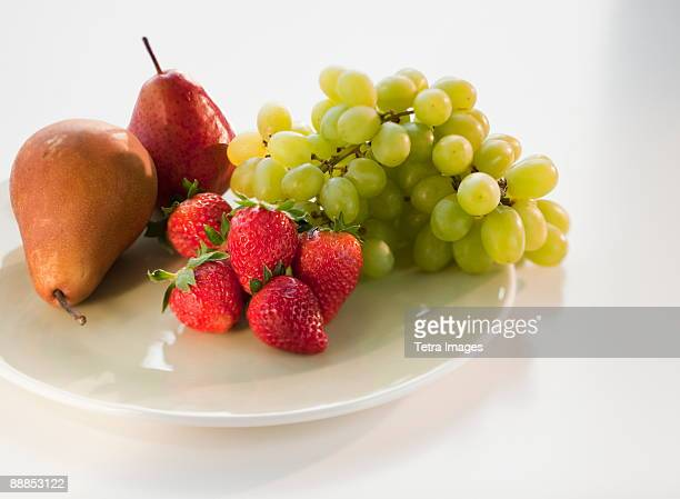Pears, grapes and strawberries on plate