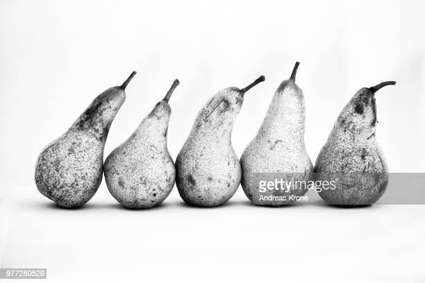 pears in a row - black and white food stock pictures, royalty-free photos & images