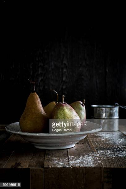 Pears On A Wood Table