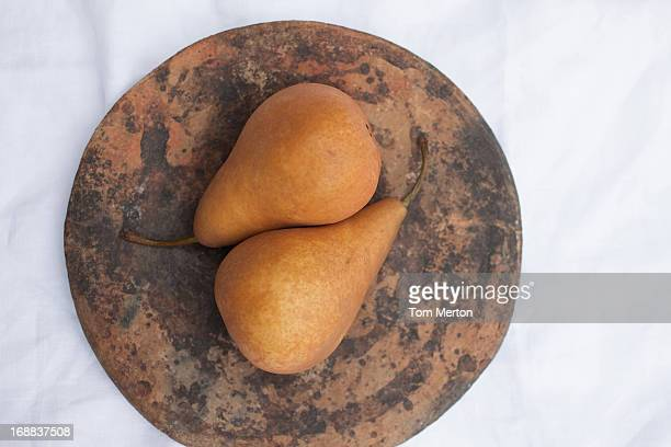 Pears on wooden circle