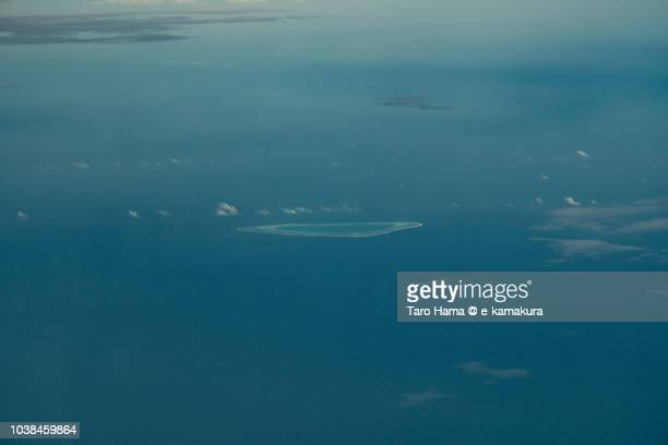 Pearson Reef in Sparkly Islands on South China Sea daytime aerial view from airplane