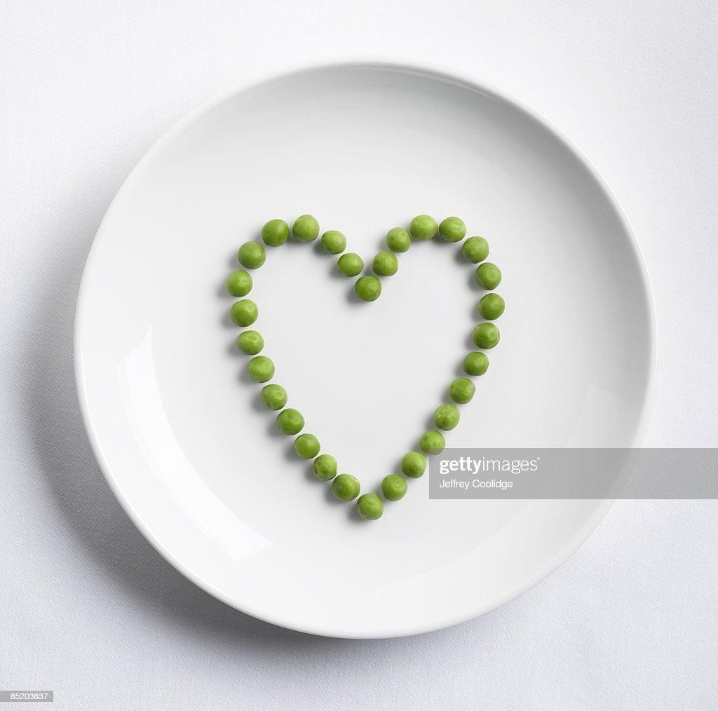 Peas in shape of heart : Stock Photo