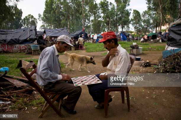 Peasant farmers play chess in an encampment opposite the national assembly and the Ministry of Agriculture in Managua demanding from the government...