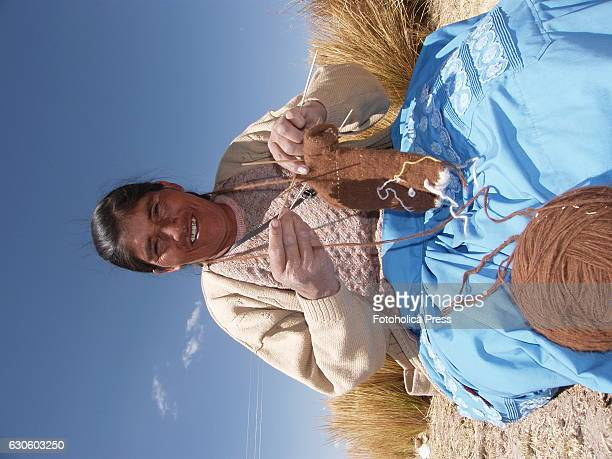 A peasant woman knitting in the prairie Indigenous women from Juliaca in the Peruvian altiplano use to meet to weave traditional products to market...