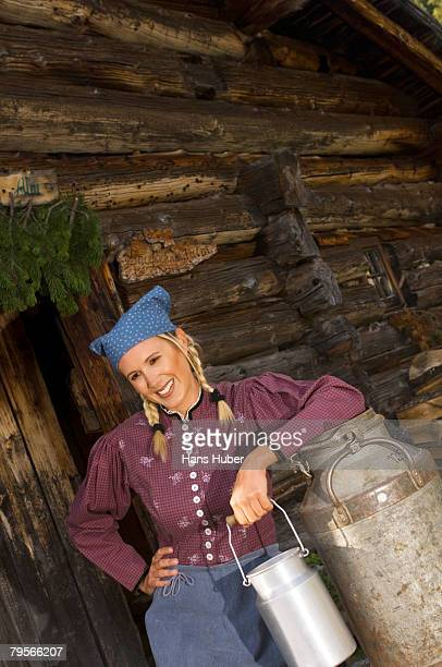 Peasant woman with milk churns