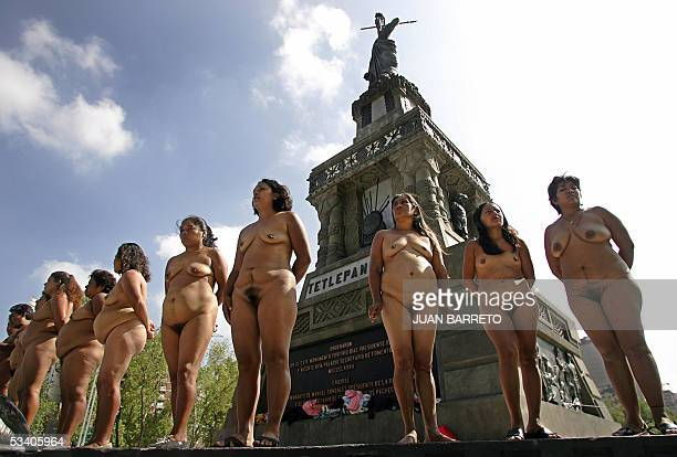 Peasant women members of the group 'Los 400 Pueblos ' demonstrate in the nude in Mexico City 18 August 2005 demanding the land that have been...