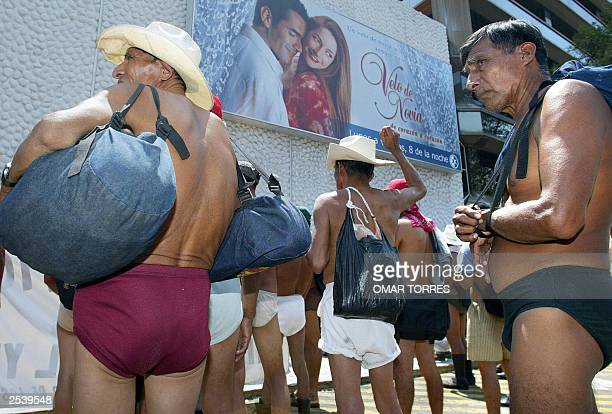 Peasants adhering to the '400 Pueblos' indigenous organization protest in underwear in front of a local TV station 26 September 2003 in Mexico City...