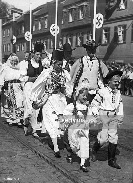 Peasants from the Siebenburgen area of Transylvania march in traditional clothes at Stuttgart circa 1940s