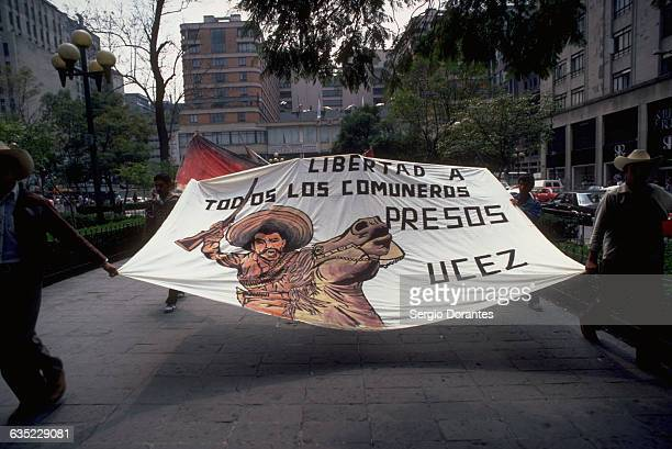 Peasants march through the streets of Mexico City with a banner of the agrarian revolutionary Emiliano Zapata Mexico 1983