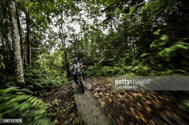 Peasants ride a motorcycle in Mataje rural area of Tumaco municipality department of Narino in the southwest of Colombia near the Pacific Ocean on...