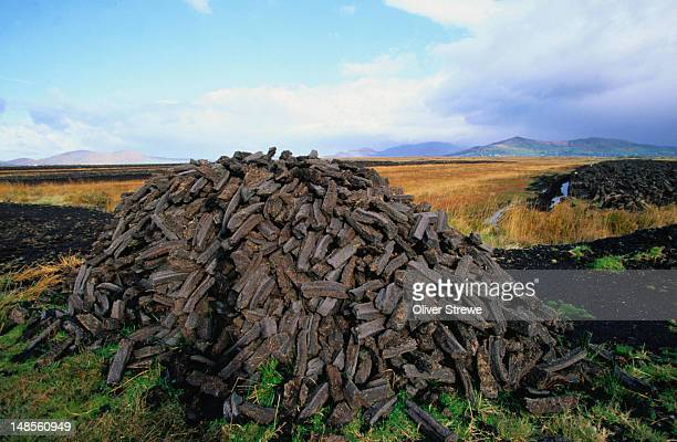 peat harvest: a pile of fuel for the fires - county kerry - harvesting stock pictures, royalty-free photos & images
