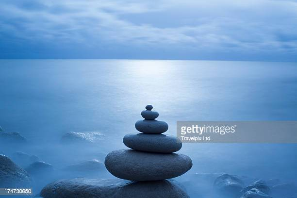pebble balancing, long exposure - tranquility stock pictures, royalty-free photos & images