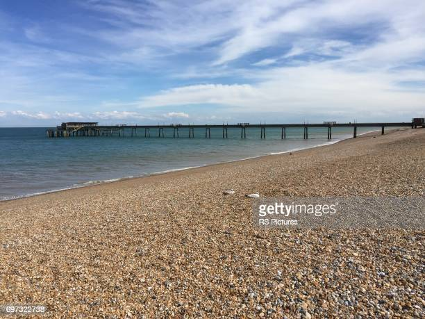pebble beach and deal pier, kent, england - deal england stock photos and pictures