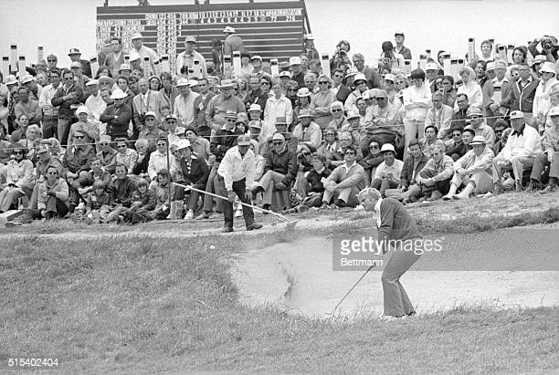 Tightly packed gallery looks on as Jack Nicklaus comes out of bunker on 8th hole during 3rd round action in the US Open Golf Tournament at Pebble...