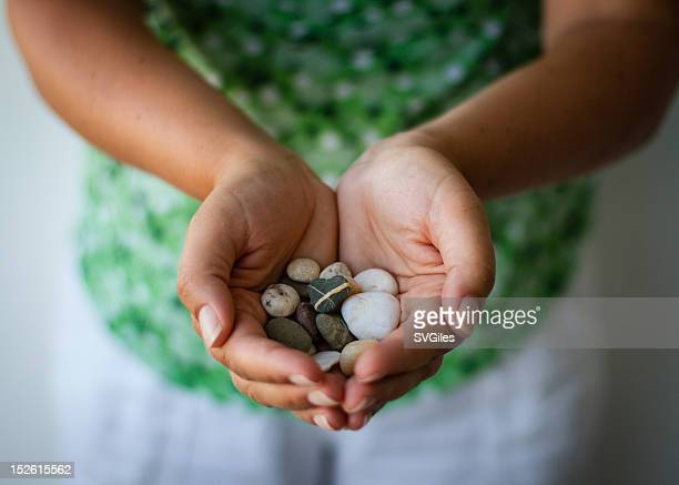 pebble hands - pebble stock photos and pictures