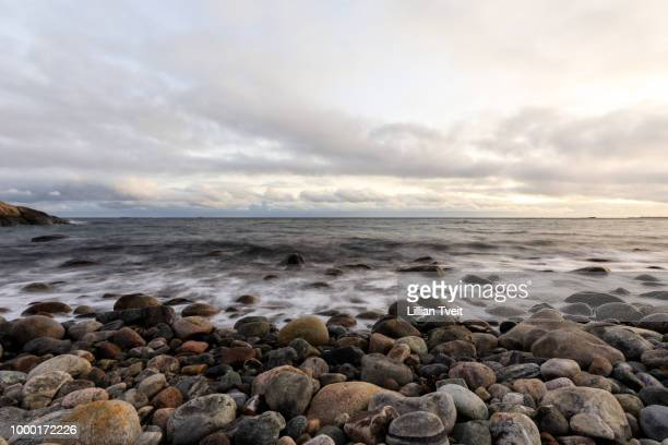 Pebble shore at Hove, Tromoy in Arendal, Norway. Raet National Park. Long exposure.