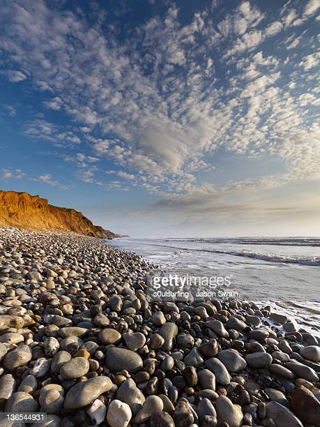 pebbles and clouds - compton bay isle of wight stock pictures, royalty-free photos & images