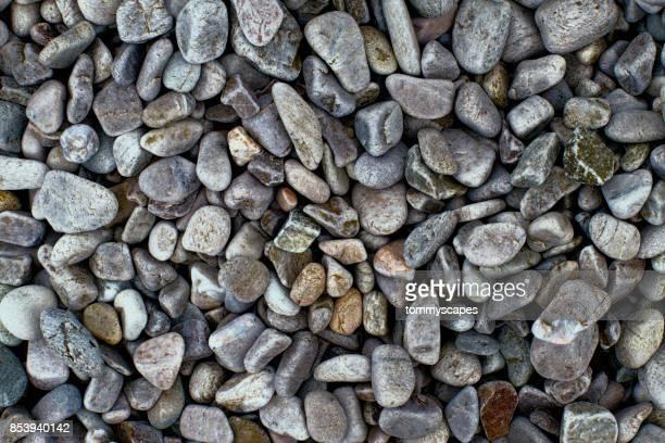 pebbles for texture - kiesel stock-fotos und bilder