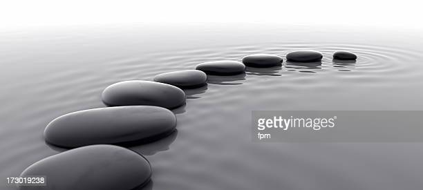 pebbles in water i - black and white nature stock pictures, royalty-free photos & images