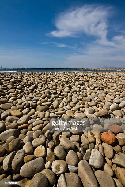 pebbles on beach against blue sky - joshua alan davis stock pictures, royalty-free photos & images