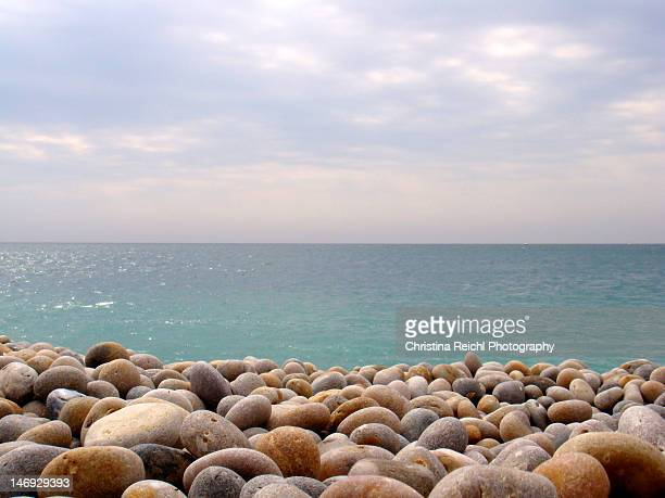 pebbles on beach - pebble stock photos and pictures