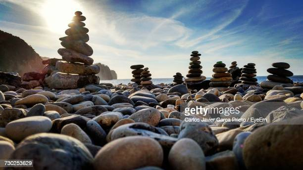 Pebbles On Rocks Against Sky