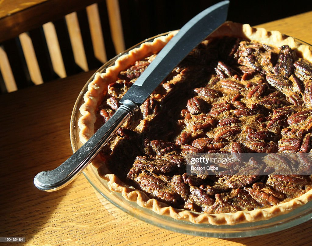 Pecan Pie waits for dessert. Barbara and John Willis make Fried chicken, Hoppin John (black-eyed peas and rice), pickled shrimp and cheese sticks . They are originally from Charleston, SC, now living in Acton.