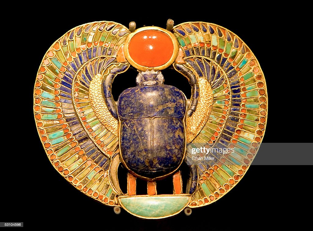 A pectoral is on display during the 'Tutankhamun And The Golden Age Of The Pharaohs' Exhibit Opening at LACMA on June 15, 2005 in Los Angeles, California. The inlaid pectoral depicts the scarab beetle Khepri, the newborn sun god. The scene spells out the throne name of Tutankhamun: Nebkheperure, meaning 'Re is the Lord of Manifestations.'