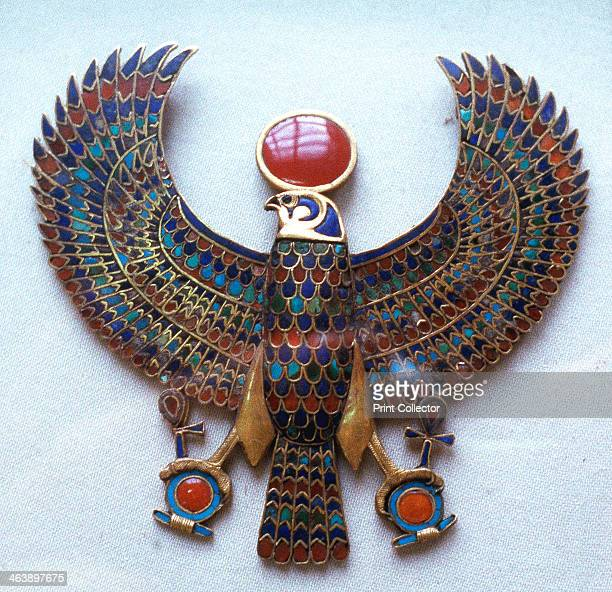 Pectoral jewel from the treasure of Tutankhamun Ancient Egyptian c1325 BC A pectoral jewel showing Horus the falconheaded god crowned with a sun disc...