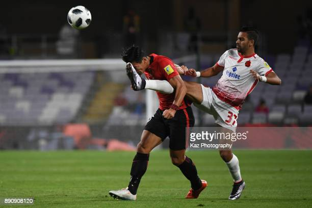 Peda Hajhouj of Wydad Casablanca fouls to Yuki Abe of Urawa Reds during the FIFA Club World Cup UAE 2017 fifth place playoff match between Wydad...