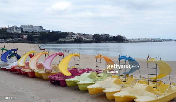Pedal beach boats with slides