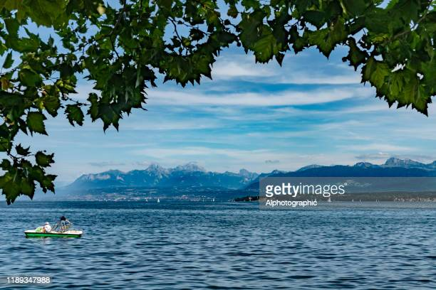 pedal boat on lake geneva, switzerland - vaud canton stock pictures, royalty-free photos & images