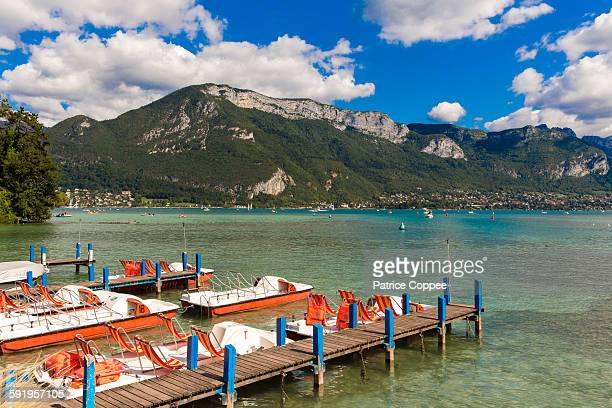 pedal boats on annecy lake - lake annecy stock photos and pictures