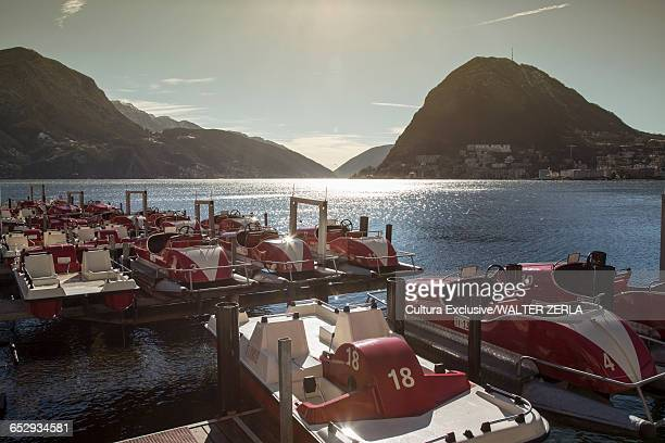 Pedalos moored on Lake Lugano, Tessin, Switzerland