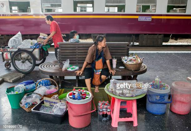 Peddlers selling snacks at Hua Lamphong train station in Bangkok