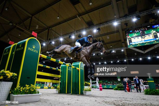 'SHERTOGENBOSCH NETHERLANDS MARCH 17 Peder Fredericson rides HM Christian K for the 3nd place during the The Dutch Masters Rolex Grand Slam of...