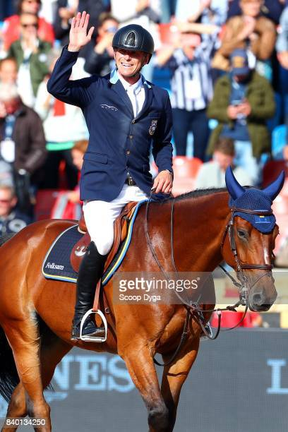 Peder Fredricson riding HM All In celebrates after winning gold medal during Jumping Individual Final of the Equestrian European Championships on...