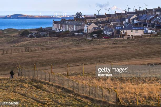 Pedestian walks along the coast path beside the proposed site of a new coal mine in Whitehaven, U.K., on Monday, Feb. 8, 2021. The U.K. Government...