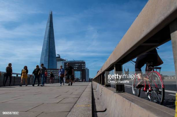Pedestrains walk over London Bridge next to a roadside barrier put in place after the terror attack on the first anniversary of the London Bridge...