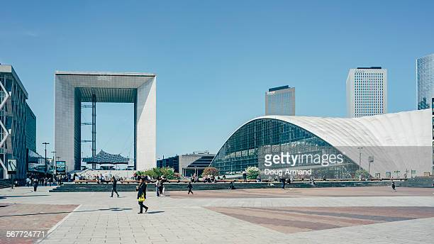 Pedestrains walk the Esplanade la Defense