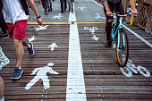 Pedestrian and bicycle riders sharing the street lanes
