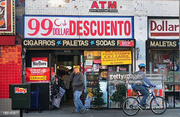 A pedestrian and cyclist pass a 99 cent store in Los Angeles on December 6 2011 US President Barack Obama lashed out at the distorting inequality...