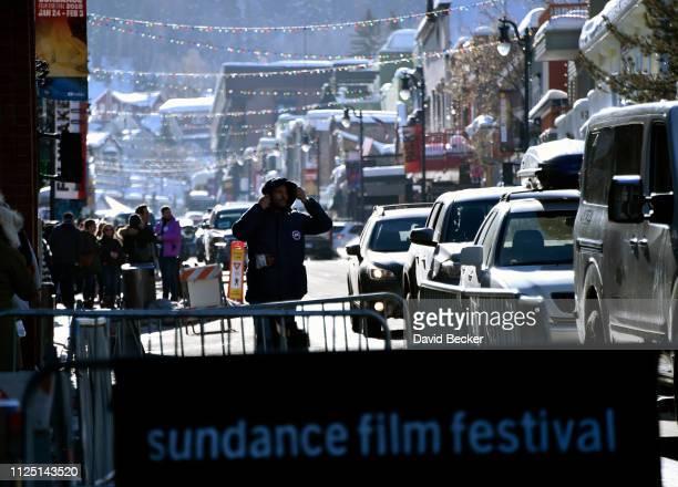 Pedestrian and vehicle traffic navigate along Main Street during the 2019 Sundance Film Festival on January 26 2019 in Park City Utah