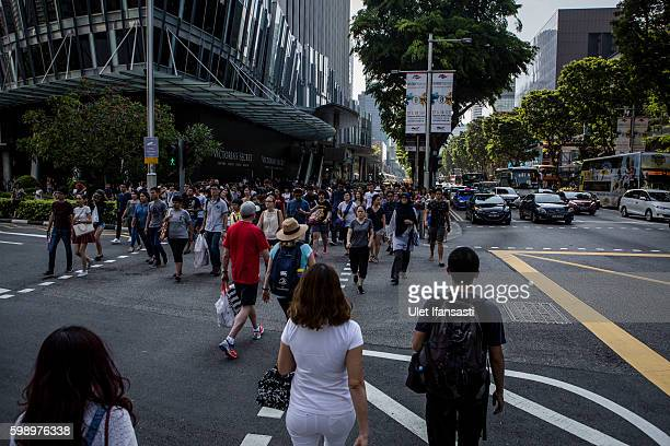 Pedestrian are seen at Orchard road on September 3 2016 in Singapore Singapore raised the number of Zika cases to 189 this week as government...