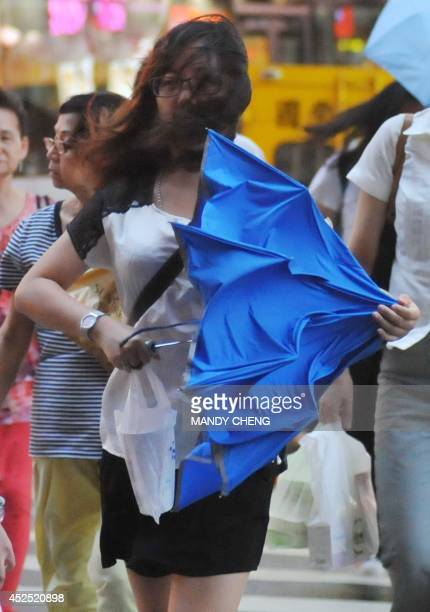 A pedestrian battles against strong winds in Taipei on July 22 2014 as Typhoon Matmo approaches eastern Taiwan Typhoon Matmo churned towards Taiwan...