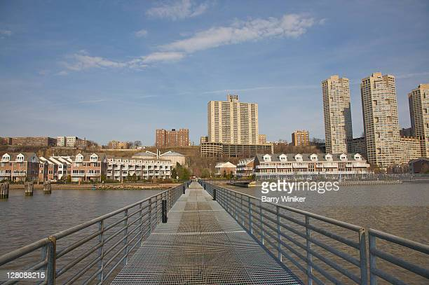 Pedestrian bridge extending into Hudson River, The Landings at Port Imperial, Weehawken, New Jersey, USA, March 2010