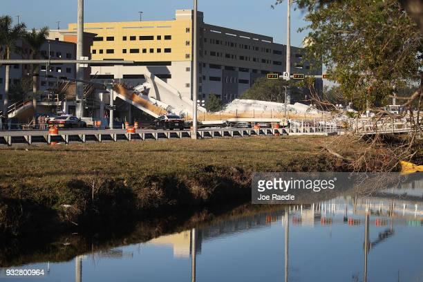 A pedestrian bridge is seen after it collapsed a few days after it was built over southwest 8th street allowing people to bypass the busy street to...