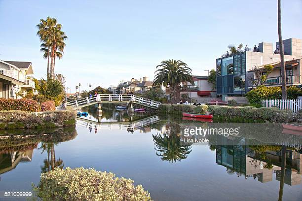 Pedestrian bridge over a canal in the Venice neighborhood in Los Angeles California The Venice neighborhood is a local landmark and attraction in Los...