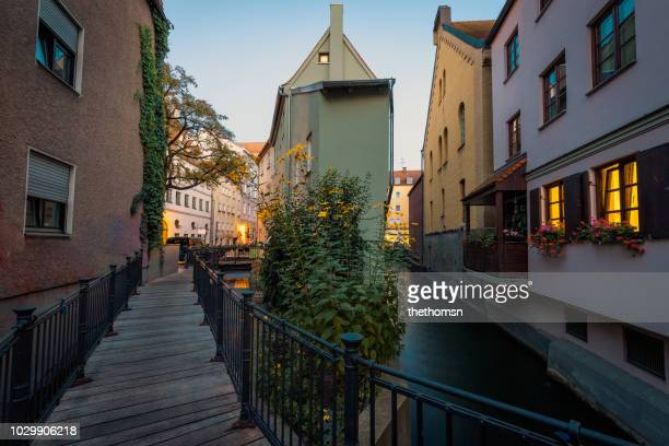pedestrian bridge over crossing of the middle and back lech canal, augsburg, germany - augsburg stock-fotos und bilder