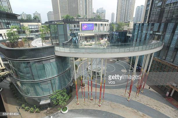 A pedestrian bridge supported by steel tubes and connecting buildings on both sides is seen on May 24 2016 in Chongqing China It's said that 36 steel...